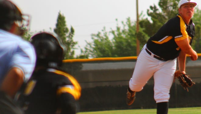 Alamogordo senior Thompson Rick releases a pitch Tuesday afternoon during game one at Tiger Field.