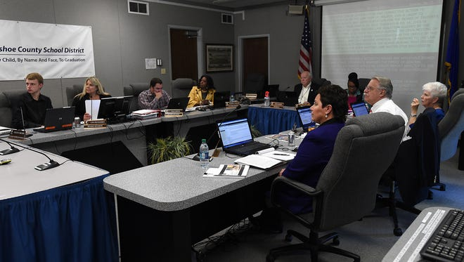 The Board of Trustees gathers for a Washoe County School District meeting in Reno on April 28, 2015.