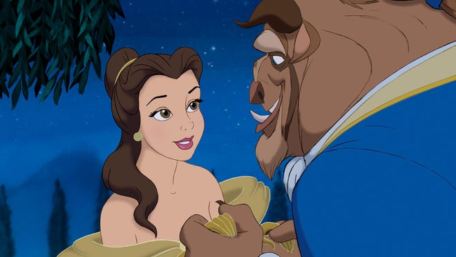 'Beauty and the Beast' celebrates its 25th anniversary this year. In this shot, Belle (voiced by Paige O'Hara) and the Beast (voiced by Robby Benson) embrace.