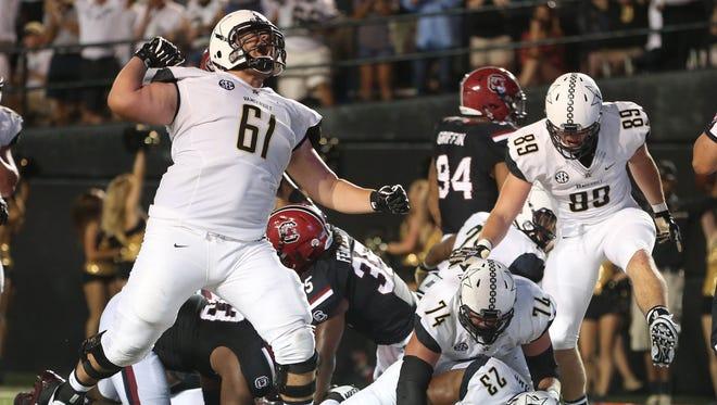 Vanderbilt offensive lineman Bruno Reagan (61) celebrates a touchdown versus South Carolina to open the 2016 season.