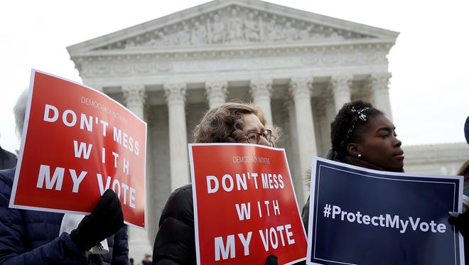Oral argument in the Ohio voter purge case brought out protesters in January.