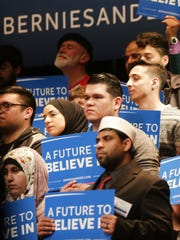 Supporters listen closely as presidential candidate Bernie Sanders speaks for about one hour  at the Michael A. Guido Theater in Dearborn on March 7, 2016.