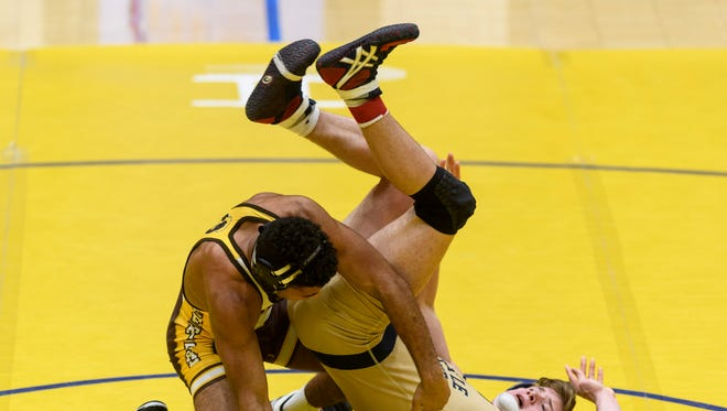 Central's Kiave Guerrier defeated Castle's Will Nunn 7-5 in overtime in the title match of the 182-pound division at the North Regional. Both advance to the semistate Saturday at Ford Center.