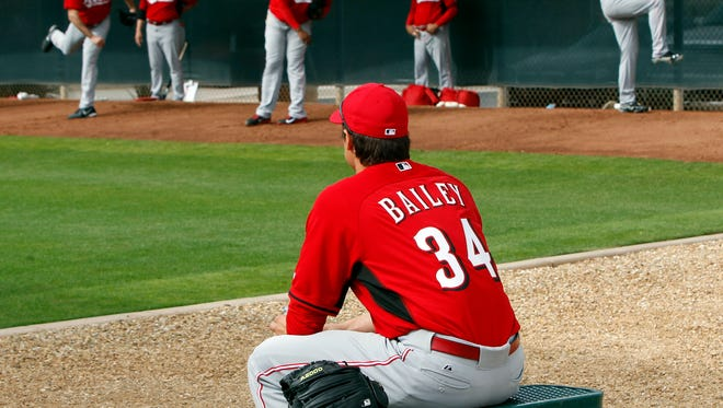 Reds right-handed pitcher Homer Bailey watches some of his teammates Friday morning.