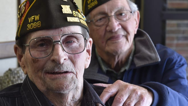 U.S. Army veterans Orville Kugler, 86, left, and Gene Schram, 92, both of Sturgeon Bay, have seen their share of wars. Kugler, who says he's full of shrapnel, earned the silver, bronze and purple heart medals. Schram helps veterans in the area with DAV information, visits and support.