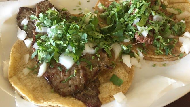 Taco Cecina, foreground, and taco barbacoa, rear, at El Rey del Taco, 3935 N. High School Road, Indianapolis.