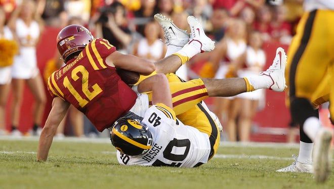 Iowa freshman defensive end Parker Hesse brings down Iowa State quarterback Sam Richardson during the Hawkeyes' 31-17 win.