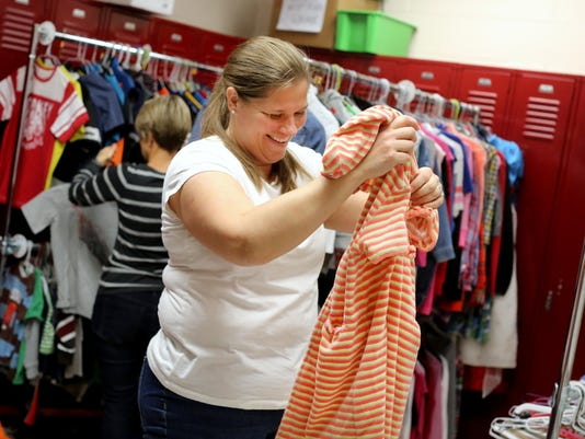 December 10, 2015. Rees E. Price, Lion's Threads, clothing, donation, Liz Dufour