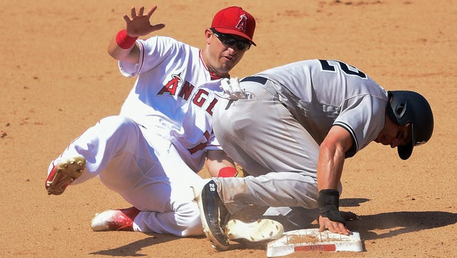 Anaheim, CA, USA; New York Yankees center fielder Jacoby Ellsbury (22) steals second base ahead of the tag by Los Angeles Angels second baseman Cliff Pennington (7) during the eighth inning at Angel Stadium of Anaheim on Sunday, August 21st, 2016. The Los Angeles Angels won 1-0.