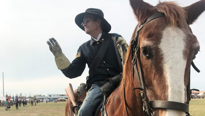 Rooster takes a pose while his rider, Ron Perry, chats with people Saturday, Dec. 2, 2017, at  Fort Concho National Historic Landmark during Christmas at Old Fort Concho.
