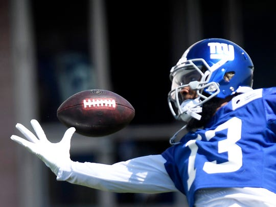 New York Giants wide receiver Odell Beckham Jr. juggles the ball during Giants minicamp in East Rutherford, NJ on Tuesday, June 12, 2018.