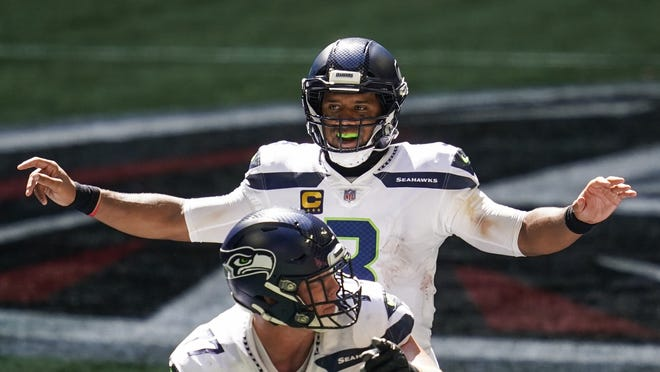 Seahawks quarterback Russell Wilson is adept at reading the opposing defense at the line of scrimmage.