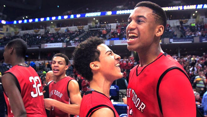 Park Tudor senior Trevon Bluiett, right, andKobe Webster begin the celebration after the Panthers captured the Class AA IHSAA boys basketball state title in an 84-57 win over the Westview Warriors at Bankers Life Fieldhouse in Indianapolis on Saturday, March 29, 2014. Art left are Jaren Jackson Jr., left, and Bryce Moore.