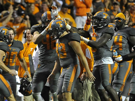 Teammates congratulate Punter Trevor Daniel after he punted the ball out of bounds on the 1-yard line.