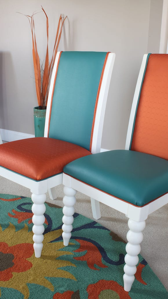 Cheerful chairs carry out the orange and teal color scheme.