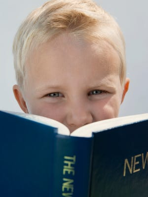 Boy Reading The New Testament
