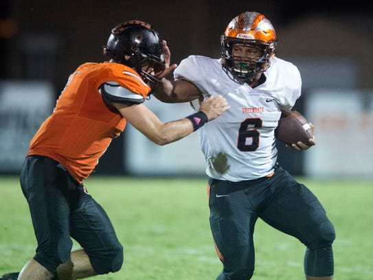 Greenback's Breeden Gilbert tries to hold off Coalfield's