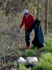 Pat Heiny searches for litter while helping with the gorge cleanup in this file photo from 2015.
