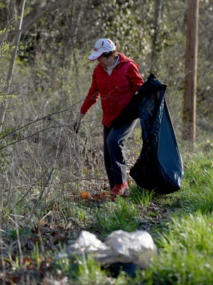 Pat Heiny searches for litter during a past Whitewater Gorge cleanup effort.