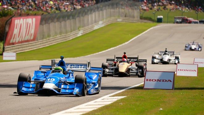 Simon Pagenaud leads  Graham Rahal and Josef Newgarden during the Honda Indy Grand Prix of Alabama at Barber Motorsports Park.