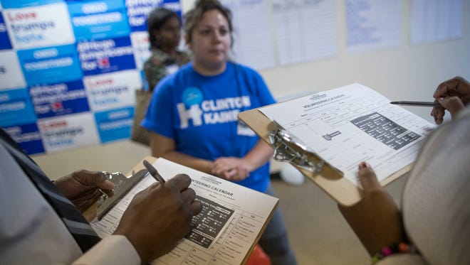 Democrats are counting on registration efforts from volunteers like these to help them build a lead during early voting, which starts Wednesday in Ohio. (AP Photo/John Minchillo)