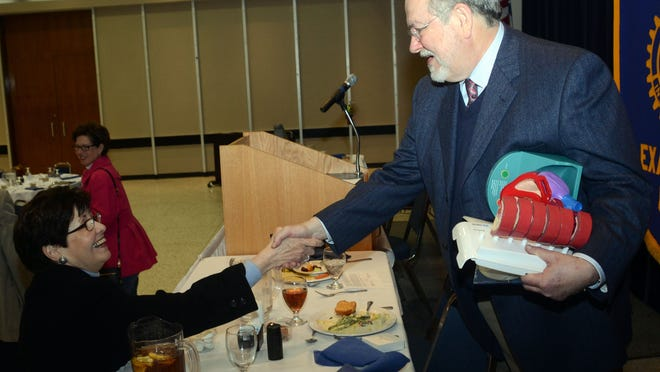 Nerine Day (left) speaks with cardiologist Dr. Robert Freedman who was the guest speaker at the Rotary Club of Alexandria Tuesday, Feb. 17, 2015.