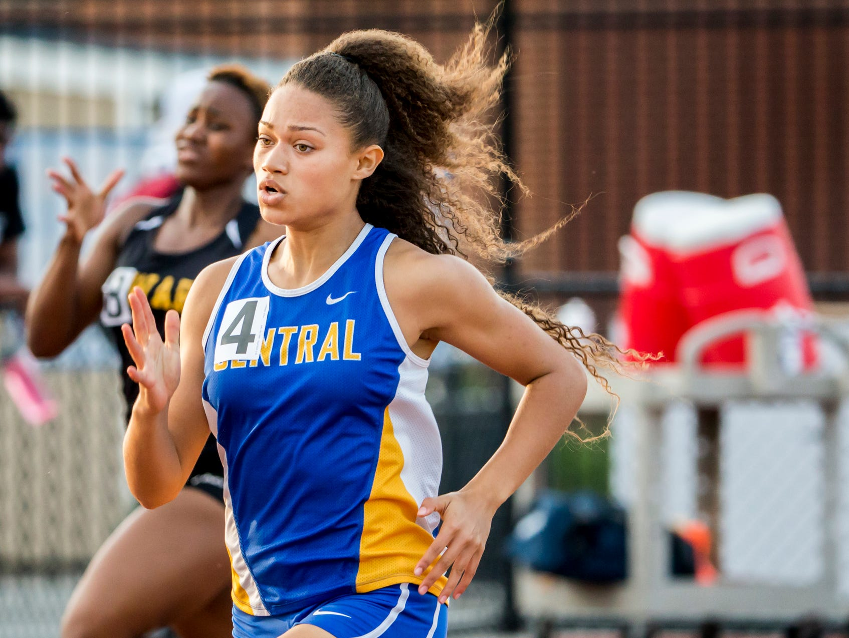 Sussex Central's Naiya Smith runs into the final stretch as she wins the Girls 400 Meter Dash at the Meet of Champions at Dover High School on Wednesday evening.
