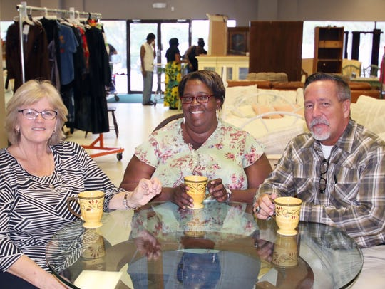 Mustard Seed Ministries Program Director Stacy Malinowski, left, with Hurricane Irma survivor Marvina Miller Spann, and Mustard Seed Executive Director Todd Smith.