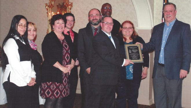 (From left) Amparo Lancara, Madelyn Frazier, Rosemary DeQuinzio, Jeff Kates, Andrew Valsamis, Kevin Haygood, Director Mark Taylor, Sarah Garrod, all from Catholic Charities, and Chris Volker, president, Vineland Service Clubs Council, are pictured at the presentation of the Vineland Service Clubs Council's 2015 Outstanding Service Club Award. Catholic Charities is the recipient of this year's award.