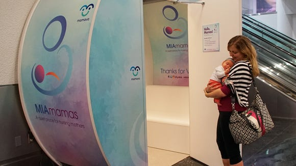 Carole Loukas with 6-month-old Kathlyn Loukas try out