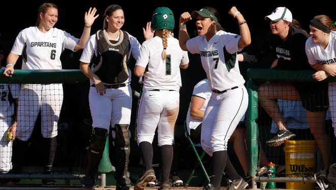 Michigan State players, including Shanin Thomas (7), Jordan Davis (6) and Lindsey Besson celebrate after Lea Foerster (1) scored against Indiana Friday, April 15, 2016, in East Lansing, Mich. Michigan State won 6-2.