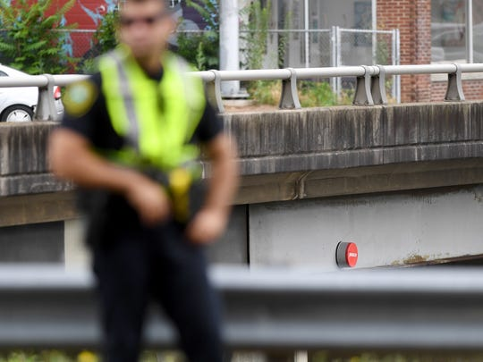 "A suspicious red and grey item reading ""peace"" attached to the Haywood Road bridge over I-240 was removed by emergency personnel on Thursday, June 22, 2017."