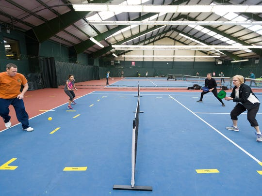 Pickleball players hit the courts at the Fair Lawn Racquet Club in New Jersey. Ontario is considering adding its own pickleball court at Marshall Park.