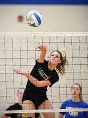 Kimball's Holly Loch spikes the ball over the net during