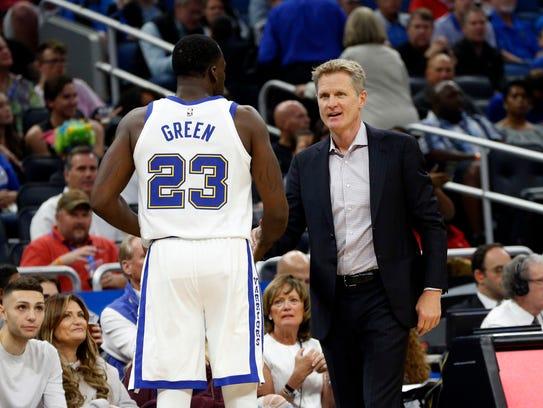 Golden State Warriors head coach Steve Kerr talks with