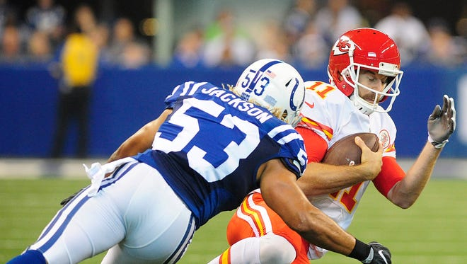 Kansas City Chiefs quarterback Alex Smith (11) gets ready to take a hit from Indianapolis Colts linebacker Edwin Jackson (53) at Lucas Oil Stadium.