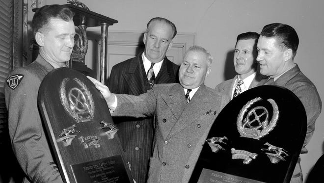 MArch 14, 1951 - The Marcus Dow Safety Trophy for 1950 was awarded to Dixie Greyhound Lines in March 1951 and drivers and officials looked forward to a third win and permanent possession of the big trophy. Holding the award for 1946 is Harold L. Seelig (left) while J.E. Ballard (right) holds the 1950 plaque. Officials around the trophy are William F. Grant (second left) of Chicago, safety director for the Greyhound Corp.; Earl W. Smith (center), president of Dixie Greyhound and Joseph A. Dalstrom (second right), safety director for Dixie Greyhound.