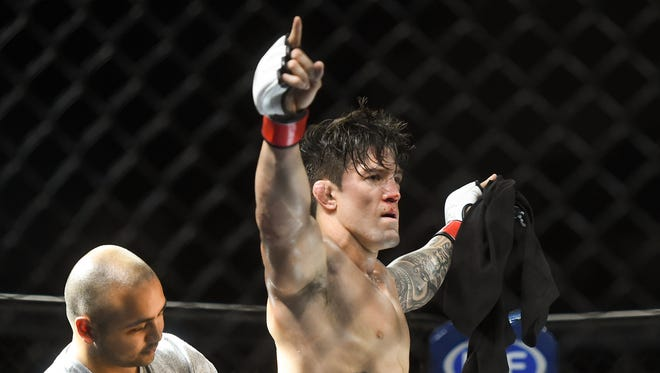JJ Ambrose celebrates his PXC 56 World Lightweight Championship win over Takahiro Ashida at the University of Guam Calvo Field House on March 25, 2017.