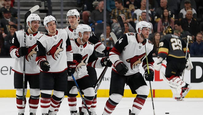 Players celebrate after Arizona Coyotes defenseman Kevin Connauton, right, scored against the Vegas Golden Knights during the second period of an NHL hockey game, Wednesday, March 28, 2018, in Las Vegas. (AP Photo/John Locher)