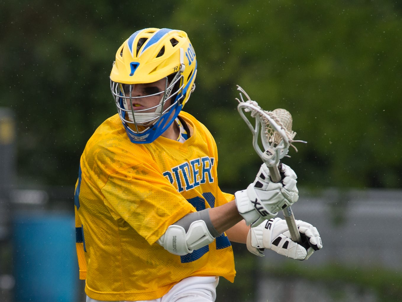 Caesar Rodney's Jacob Pangle (22) runs with the ball in their home game against Tower Hill.