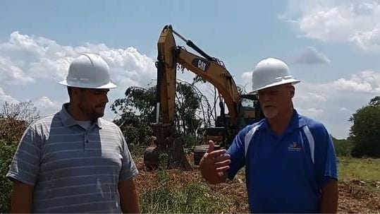 From left, Christ Doughtie, Tennessee Children's Home Development Director, speaks with President Brian L. King during the groundbreaking of the campus' new site, which will be located on Dr. Robertson Road.