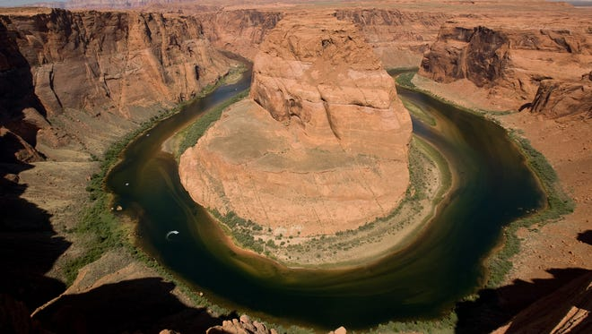 In one of the great vistas of the Vermilion Cliffs, the Colorado River curves around Horseshoe Bend in Glen Canyon.