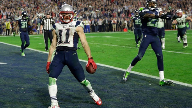 New England Patriots wide receiver Julian Edelman reacts after catching a 3-yard touchdown pass during the second half of NFL Super Bowl XLIX against the Seattle Seahawks on Sunday in Glendale, Ariz.