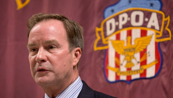 FILE - In this Sept. 10, 2014 file photo, Attorney General Bill Schuette speaks at the Detroit Police Officers Association in Detroit. Michigan's attorney general Schuette will announce criminal charges Wednesday, April 20, 2016, against two state regulators and a Flint employee, alleging wrongdoing related to the city's lead-tainted water crisis, according to government officials familiar with the investigation.