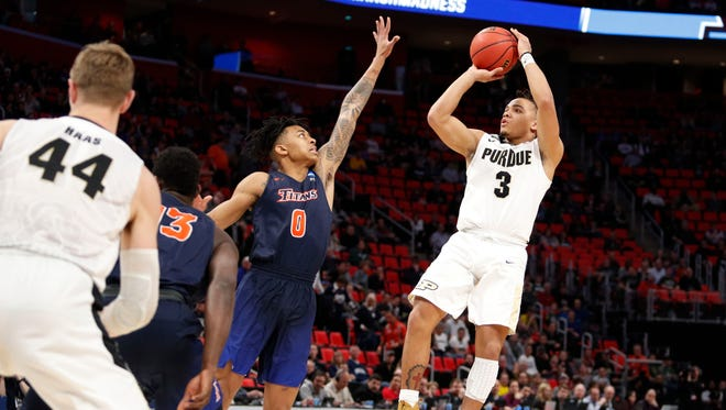 Boilermakers guard Carsen Edwards (3) shoots over Cal State Fullerton Titans guard Kyle Allman (0) in the first half in the first round of the 2018 NCAA Tournament at Little Caesars Arena.