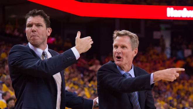 Golden State Warriors assistant coach Luke Walton (left) and head coach Steve Kerr (right) react during the second quarter in Game 1of the first round of the NBA Playoffs against the New Orleans Pelicans at Oracle Arena. The Warriors defeated the Pelicans 106-99. Both Kerr and Walton played at the University of Arizona.
