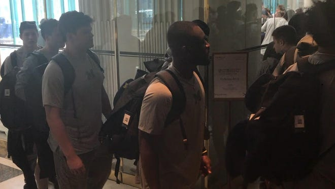 Members of the Michigan football team arrive in Paris on April 27, 2018 for their spring trip.