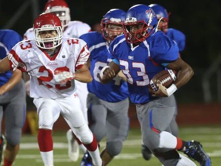 Carmel's John Morris III (33) looks for some running room in the North Rockland defense during football action at Carmel High School Sept. 25, 2015.