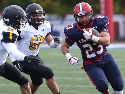 Stepinac's Antonio Giannico (23) finds some running room in the Saint Anthony's defense during a football game at Stepinac High School in White Plains Oct. 17, 2015. Stepinac won the game 49-32.