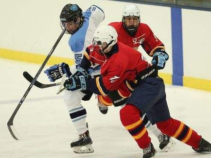 Suffern's Reed Stark (15) and Pelham's Will Case (13) battle for possession at the red line during a varsity ice hockey game at Sport -O-Rama in Monsey on Saturday, Nov. 28, 2015.